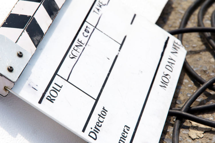 Film Slate, clapper board Behind The Scenes Behindthescenes Clapper Board Close-up Communication Day Film Industry Film Slate No People Number Paper Text