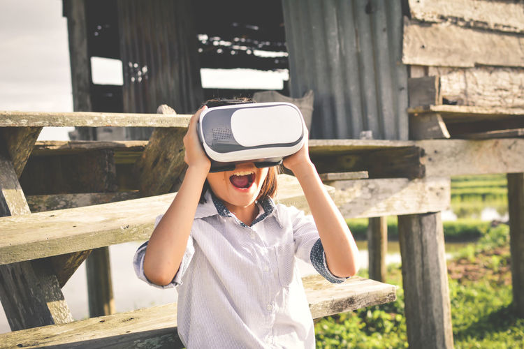 Boy using virtual reality simulator