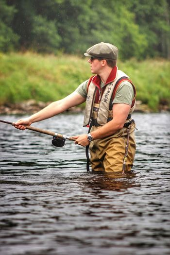Fishing on the River Spey Water Real People One Person Leisure Activity River Nature Outdoors Fishing Day Holding Adventure Lifestyles Young Adult Men Fishing Tackle Scottishriver Sporting Riverspey Fishingrod Waders Wading