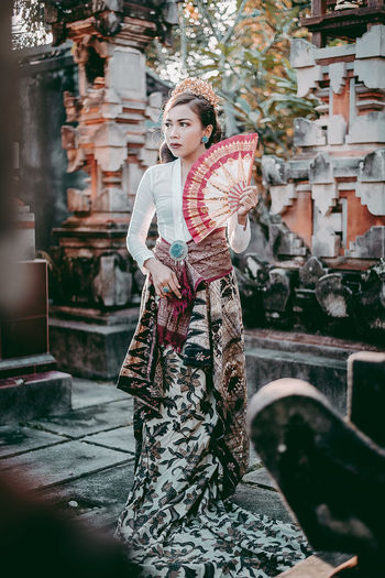 Full length of woman in traditional clothing standing outdoors