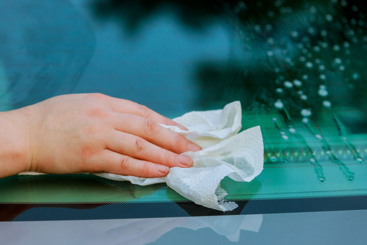 outdoor car wash with girl washes the microfiber cloth cleaning car. at parking lotcar Automobile Car Wash Cleaning Service Shine Woman Car Clean Day Glass Hand Human Hand Microfiber One Person Polish Real People Soap Vehicle Wash Water