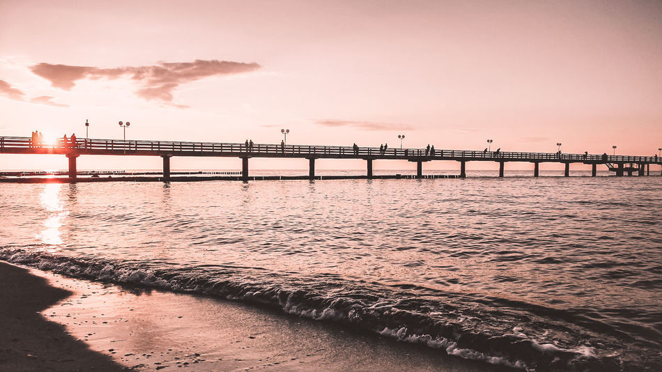 The Sun goes Down on the Bridge Baltic Sea Ostsee Seebrücke Travel Architecture Beach Beauty In Nature Bridge - Man Made Structure Built Structure City Connection Day Horizon Over Water Kühlungsborn Nature No People Outdoors Scenics Sea Sky Sunlight Sunset Transportation Travel Destinations Water EyeEmNewHere