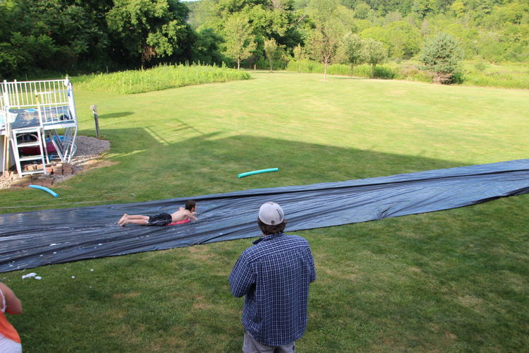 authentic red-neck slip and slide Fun Summer Fun ☀️ Day Family Fun Grass Leisure Activity Outdoors Party Games People Redneck Redneck Good Times Redneck Summer Games Slip N Slide Water