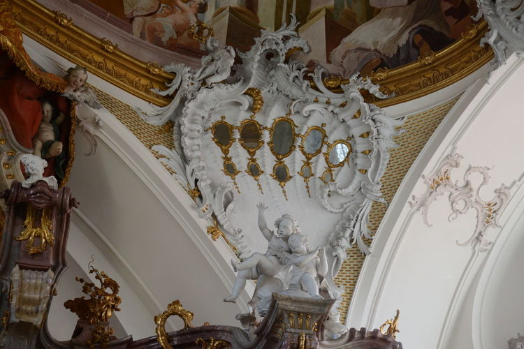 Low angle view of statues on ceiling of building