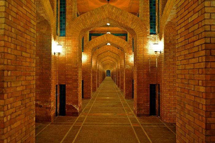 Indoors  Built Structure Illuminated Brick Wall No People Architecture Arch The Way Forward Building Brick Mosque Mosques Of The World Mosque Architecture Grand Mosque Place Of Worship Building Exterior Architecture Red Bricks Abstract Symetryart Symetrical Building Symmetry Symetrical Pattern Brick Wall