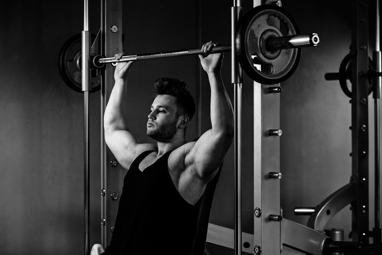 bodybuilder workout in gym with heavy weights. monochrome One Person Lifestyles Sport Energy Active Weight Training  Weightlifting Body & Fitness Bodybuilding BodyBuilder Motivation Fitness Males  Caucasian Gym Indoors  Bodybuildingmotivation Acitivity Pumping Muscles Strength Biceps Workout