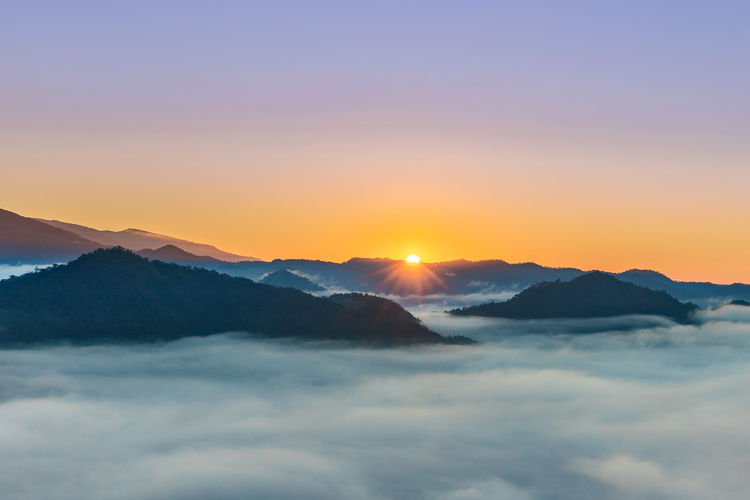 Sunrise in the morning with fog and mountain, Chiang mai, Thailand Sunrise Chiang Mai | Thailand Thailand ASIA Sky Mountain Beauty In Nature Scenics - Nature Sunset Tranquil Scene Tranquility Cloud - Sky Mountain Range Sun Nature Idyllic Orange Color No People Non-urban Scene Environment Majestic Sunlight Outdoors Copy Space Lens Flare Mountain Peak