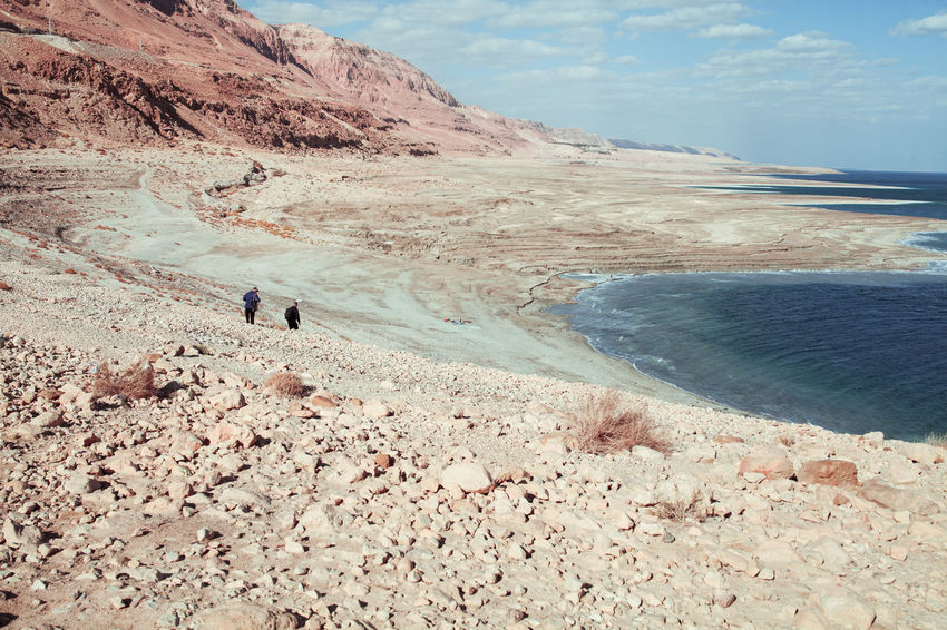 The Dead Sea Middle East Rock Salt Adventure Beauty In Nature Day Dead Sea  Full Length Leisure Activity Lifestyles Men Mountain Nature One Person Outdoors People Real People Road Trip Rocks Scenics Sea Sky Tranquil Scene Vacations Water