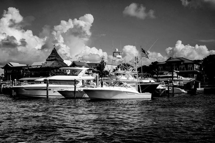 The Harbour Yachts Seascape Photography Black And White Photography Blue Water Blue Sky Harbour View Seashore Chiaroscuro Gallery Light And Shadow Clouds marina in the bay