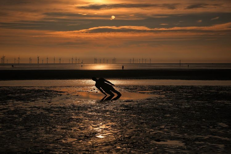 Crosby Beach Sky Scenics - Nature Water Beauty In Nature Sea Nature Crosby Beach Sunset Cloud - Sky Orange Color One Person Silhouette Real People Land Beach Lifestyles Horizon Leisure Activity Horizon Over Water Outdoors