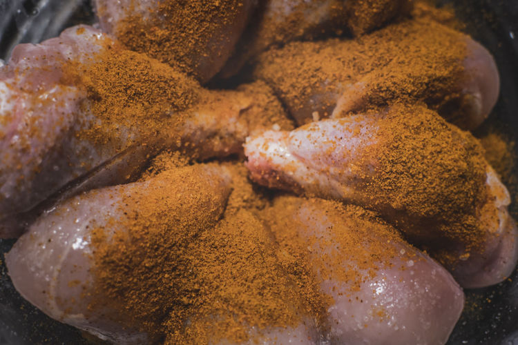 seasoning on meat Chicken Chicken Legs Chili  Chili Powder Close-up Cooking Dry Rub Food Food And Drink Food And Drink Freshness Hot Indian Food Legs Marinade Marinating Orange Powder Powder Raw Raw Meat   Ready-to-eat Spice Mixture Spicy Spicy Food Turmeric