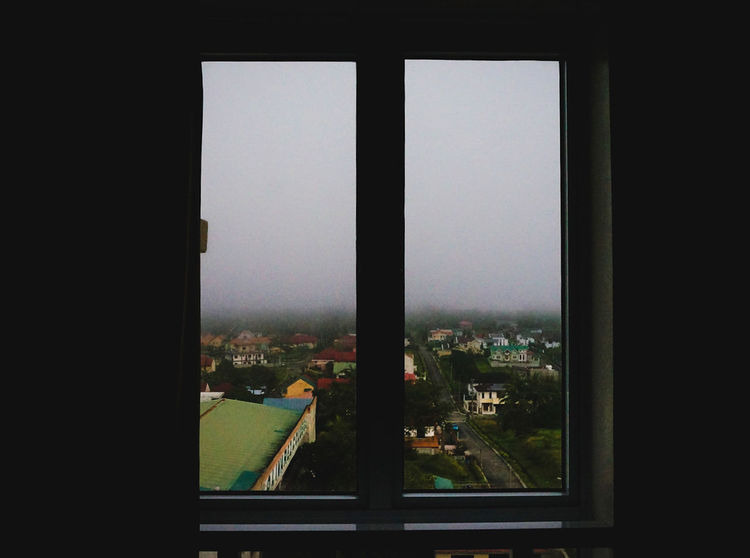 F O G G Y Foggy Weather Philippines View From The Window... Architecture Building Exterior Built Structure City Cityscape Clear Sky Close-up Day Fog Foggy Foggy Day Foggy Landscape Foggy Morning Indoors  Nature No People Sky Travel Destinations Tree Window Window View Windows EyeEm Ready   Shades Of Winter An Eye For Travel The Graphic City EyeEmNewHere Colour Your Horizn