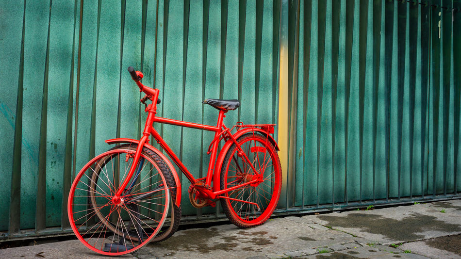 Abandoned bicycle in the city. Bicycle No People Red Wheel Creativity Parking Green Color Outdoors Abandoned Out Of Order Destroyed Streetphotography City Life City Street City Details 2018 In One Photograph