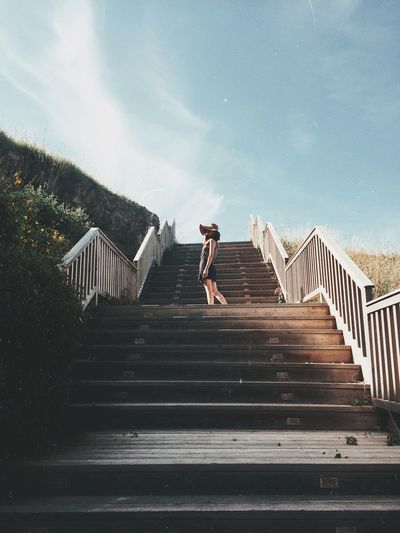 If you don't know where you're going, any road will get you there. Staircase Railing Sky Full Length One Person Walking Steps And Staircases Architecture Women Nature Bridge Day Outdoors Built Structure Lifestyles