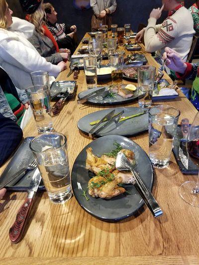 High angle view of people eating food on table