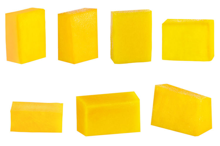 Close-up of yellow soap over white background