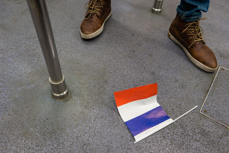 Low section of person by flag on ground