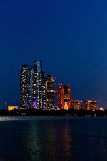 Abu Dhabi Clear Sky Lights Nightphotography Skyscrapers Architecture Blue Building Built Structure City Cityscape Clear Sky Illuminated Landscape Modern Night Night View No People Outdoors Sea Sky Skyscraper Urban Skyline Water Waterfront