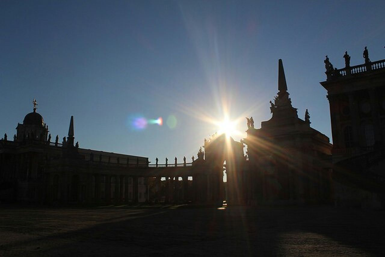 architecture, sky, sun, sunbeam, built structure, building exterior, sunlight, lens flare, nature, history, the past, travel destinations, silhouette, back lit, no people, travel, city, building, clear sky, sunset, bright, government, streaming