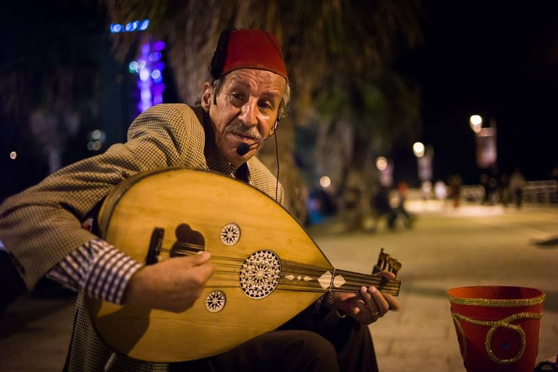 Abou Rita is a sweetold man that earn his living by playing the Oud instrument and singin beautiful Lebanese and Arabic tarab songs at Beirut's corniche. Oud  Singer  Streetphotography Street Performer Beirut Lebanon Lebanese Traditional Costume Lebaneseheritage Learn & Shoot: Working To A Brief