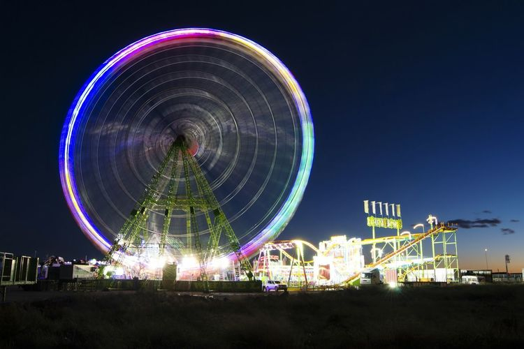 Night Amusement Park Ferris Wheel Arts Culture And Entertainment Amusement Park Ride Long Exposure Fun Park - Man Made Space Nightlife Outdoors Illuminated Multi Colored Turning Noria Noria, Feria Atraction Park Speed Alicante Alicante, Spain Alicante City Alicantelove Diversion Light In The Darkness Lights People And Places