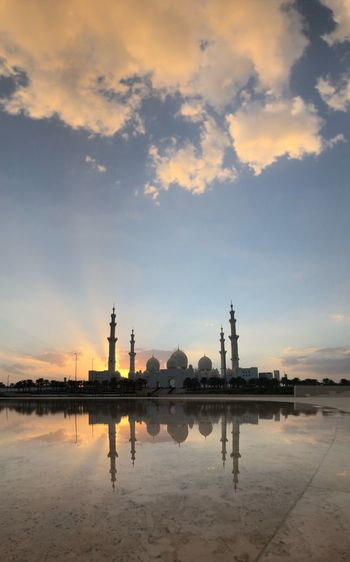 Abu Dhabi Sheikh Zayed Grand Mosque UAE EyeEm Selects Sky Reflection Water Cloud - Sky Sunset Nature Architecture Waterfront Built Structure No People Outdoors Building Exterior Lake Land Travel Destinations Scenics - Nature Beauty In Nature Orange Color