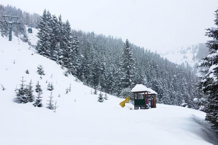 Ski lift against sky during winter