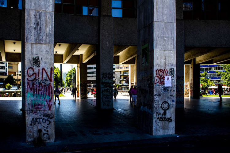 Graffiti on street amidst buildings in city