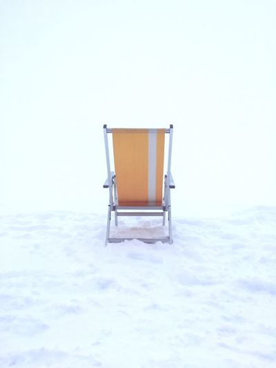EyeEm Selects Chair Holiday Winter Snow Cold Temperature Whiteout Österreich Sölden Ski Holiday Snow ❄ Weather No People Yellow No One Calm Nature Day Outdoors Clear Sky Creative Space