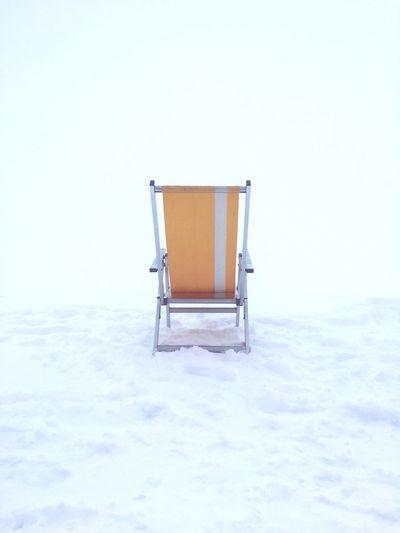 Lifeguard hut on snow against clear sky