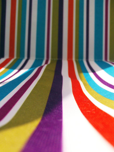 Full frame shot of colorful striped deck chair