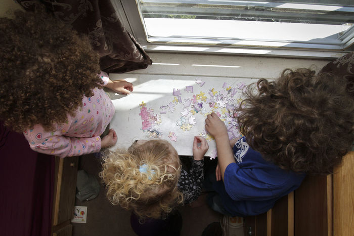 Kids with a puzzle Day High Angle View Kids Being Kids Person Play Together Puzzle Time Togetherness Window