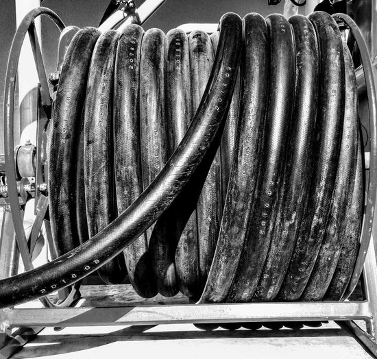 Wound up Pipe Plastic Pipe Rolled Up Pipe Black And White Hosepipe Firehose