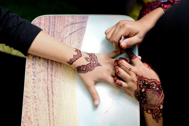 Close-up of henna hands
