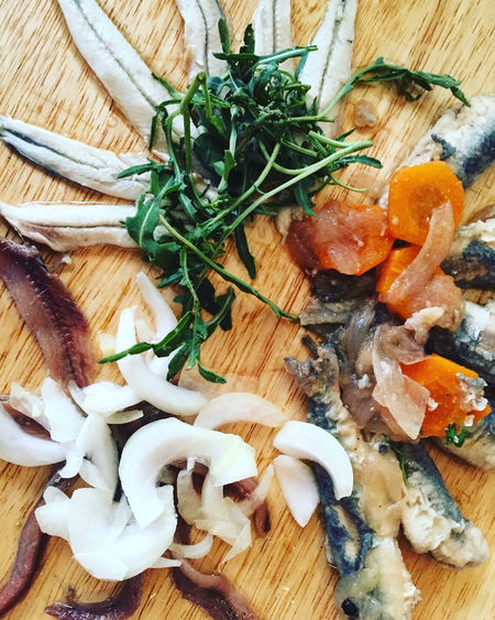Marinated fish served on wooden board top view Anchovies Appetizer Board Close-up Dinner Directly Above Dish Fish Food Food And Drink Gourmet Lunch Marinated Meal Mediterranean  Organic Plate Preparation  Salted Sardine Sardines Seafood Table Vegetables Wooden