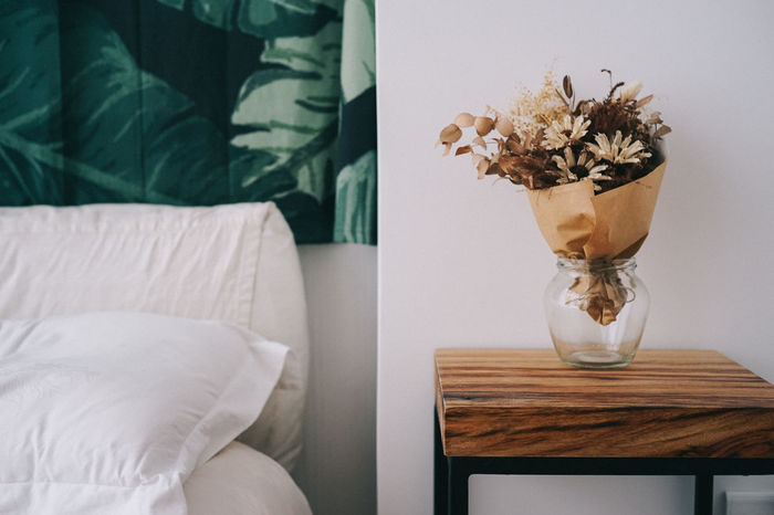Bed Bedroom Close-up Comfortable Day Dryflower Flower Home Interior Home Showcase Interior Indoors  Leaf Nature No People Pillow Side Table Table Vase Investing In Quality Of Life