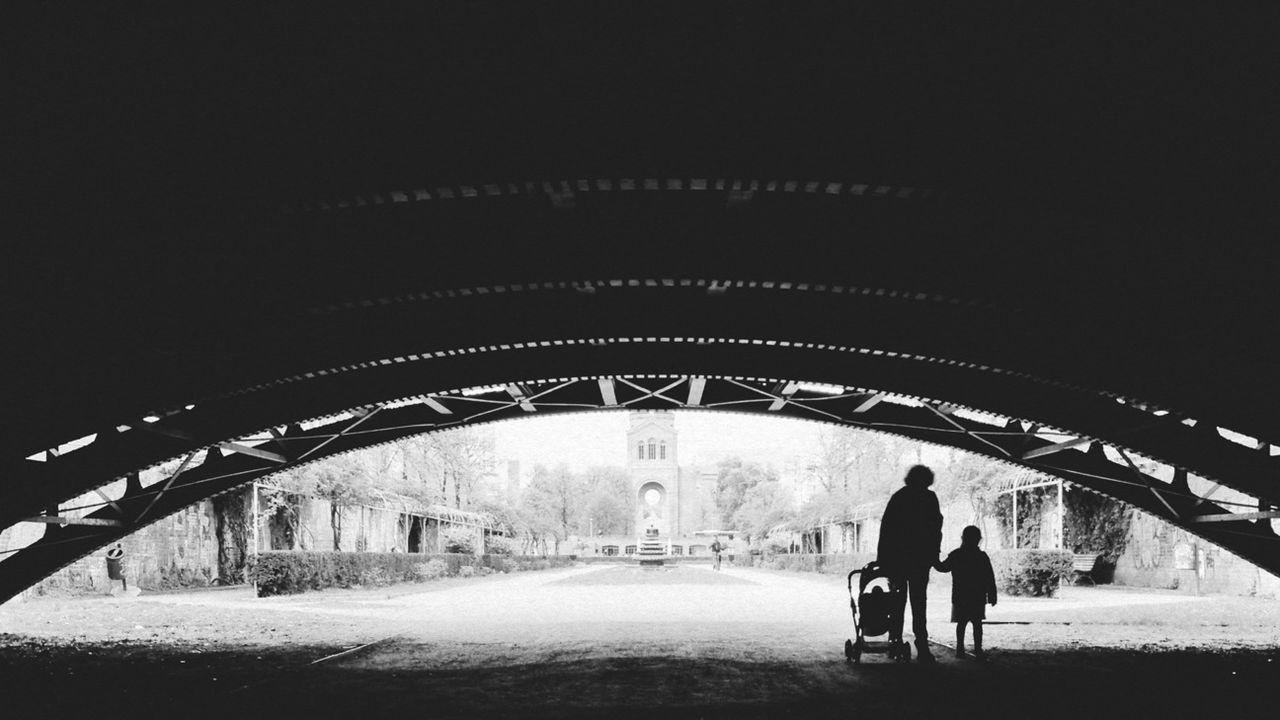 WOMAN WALKING IN TUNNEL