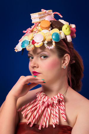 Retro candy 90s 90s Candy Store Retro Retro Candy 90s Snack Sugar Beautiful Woman Beauty Black Background Blue Candy Candy Corn Chocolate Candy Fashion Front View Hairstyle Headshot Indoors  Leisure Activity Lifestyles Looking Looking Away Make-up One Person Portrait Real People Studio Shot Sweet Food Women Young Adult Young Women