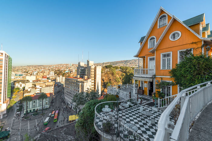 VALPARAISO, CHILE - MAY 27: View of an orange house and a bustling square in the UNESCO World Heritage city of Valparaiso, Chile on May 27, 2014 Architecture Bright Building Chile City Colorful Colors Construction Heritage Hill Home House Latin Orange Overlooking Painting South America Street Sunny Tourism Unesco Urban Valparaíso View Vintage