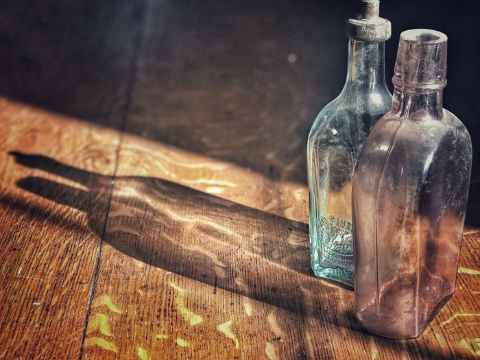 Close-up of empty bottles on table