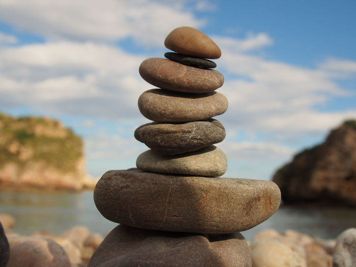 Close-up of stack of stones by the sea