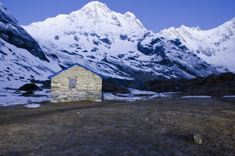 Annapurna Mountain Twilight; Annapurna Base Camp; Gandaki Zone; Annapurna; Masif; Nepal; Himalaya; Annapurna; Himalayas; Asia; Mountain Beauty In Nature Building Exterior Built Structure Cold Temperature Day Mountain Mountain Range Nature No People Outdoors Scenics Sky Snow Snowcapped Mountain Tranquil Scene Tranquility Winter