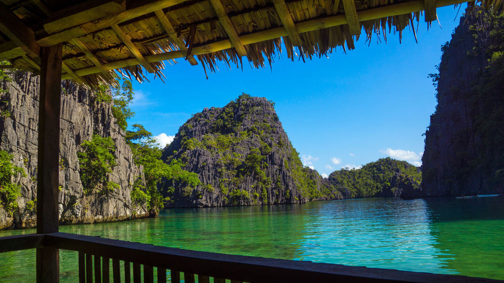 View of limestone cliffs and tropical lagoon from beach bungalow Beach Hut Coron Coron Island Coron Palawan Exotic Exotic Location Iconic Island Holiday Island Living Island Time Island View  It's More Fun In The Philippines Kayangan Lake Lagoon Limestone Limestone Cliffs Palawan Palawan Philippines Paradise On Earth Philippines Photos Simple Life Simple Living The Good Life Twin Lagoon Wow Philippines