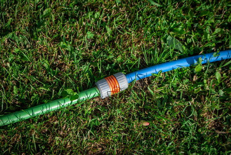Garden Cool Nature Photography Blue Cable Close-up Connection Day Equipment Field Garden Garden Hose Garden Photography Gardening Equipment Grass Green Color Growth High Angle View Hose Land Nature No People Outdoors Park Pipe - Tube Plant