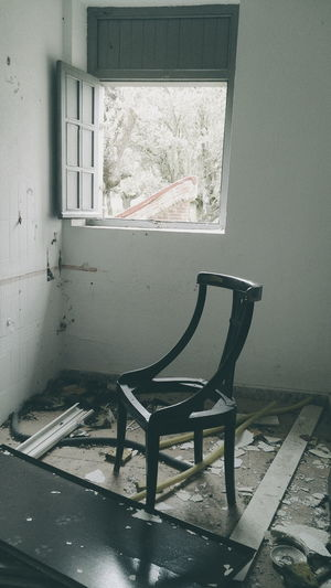 Broken chair illuminated Absence Architecture Built Structure Chair Closed Day Deterioration Empty Furniture No People