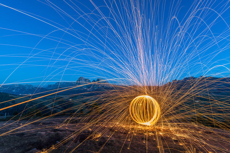 Dolomites fireworks Long Exposure Blue Hour Dolomites Mountains Fireworks Wire Wool Motion Glowing Illuminated Spinning Light Painting Night Sparks Sky Outdoors