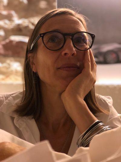 Close-Up Of Thoughtful Woman Wearing Eyeglasses