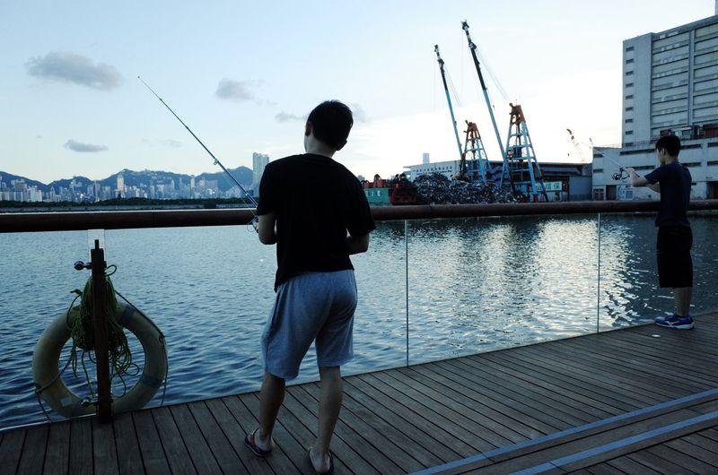 People fishing in harbor dock