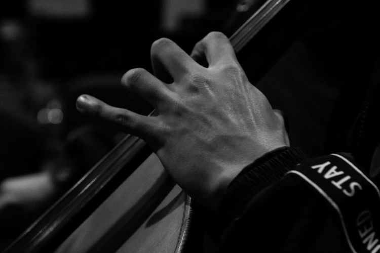 Cropped hand of man playing cello