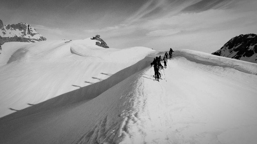 Ski Mountaineers Climbing Snowy Mountains